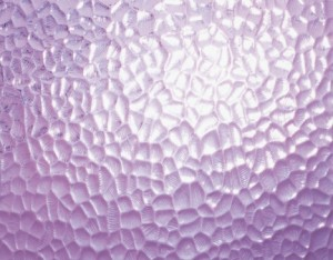 Ripply surface of frosted glass in purple
